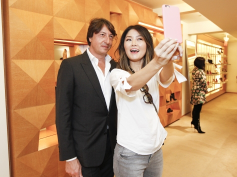 SAN FRANCISCO, CA - AUGUST 25: Gianvito Rossi and Jane Kim pose for a photograph at Barneys New York hosts an afternoon of shopping with designer Gianvito Rossion August 25, 2015 in San Francisco, California. (Photo by Kimberly White/Getty Images for Barneys New York)